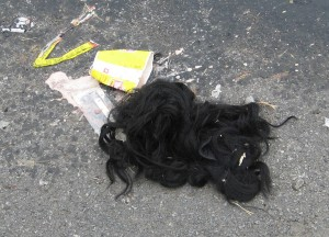 A Wendy's cup, Slim Jim, melted ice cream, and a wig. Are these clues or just an unrelated pile of stuff in the road?